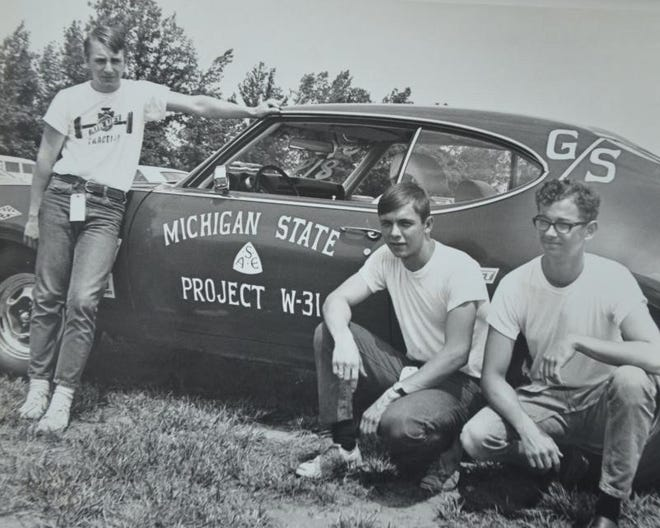 Members of the Michigan State University Society of Automotive Engineers pose with their 1969 Oldsmobile Cutlass W-31 in the early 1970s. Members are now trying to locate the car, which none of them have seen since 1974.