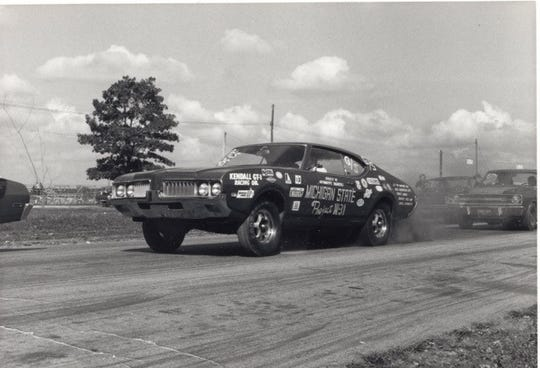 A 1969 Oldsmobile Cutlass W-31 outfitted by MSU students in the early 1970s races at a drag strip. Members are searching for the car, which they lost track of in 1974.