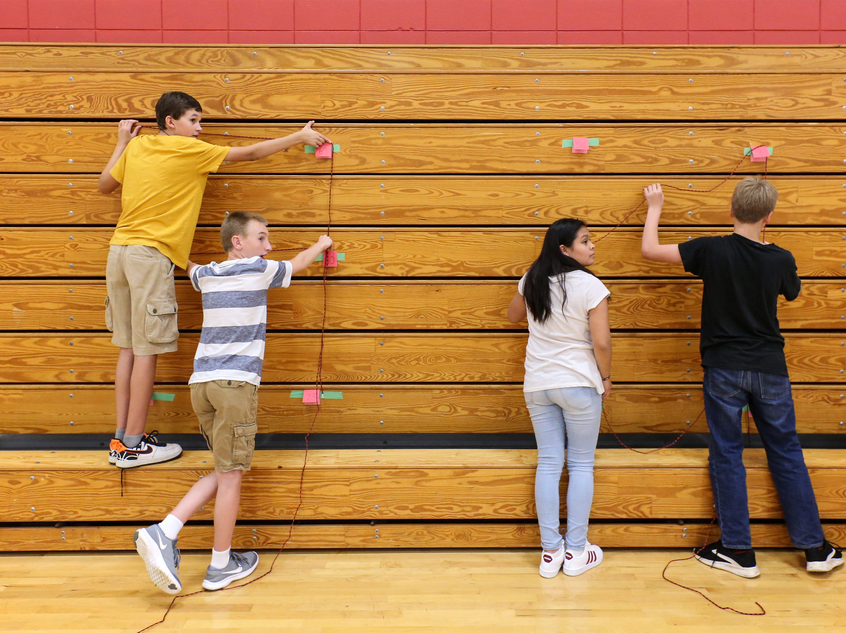 Jeff Cavanaugh's 8th grade homeroom search for the next clue during an escape room activity on the first day of school at Wilson Junior High Tuesday, September 4, 2018, in Manitowoc, Wis. Josh Clark/USA TODAY NETWORK-Wisconsin