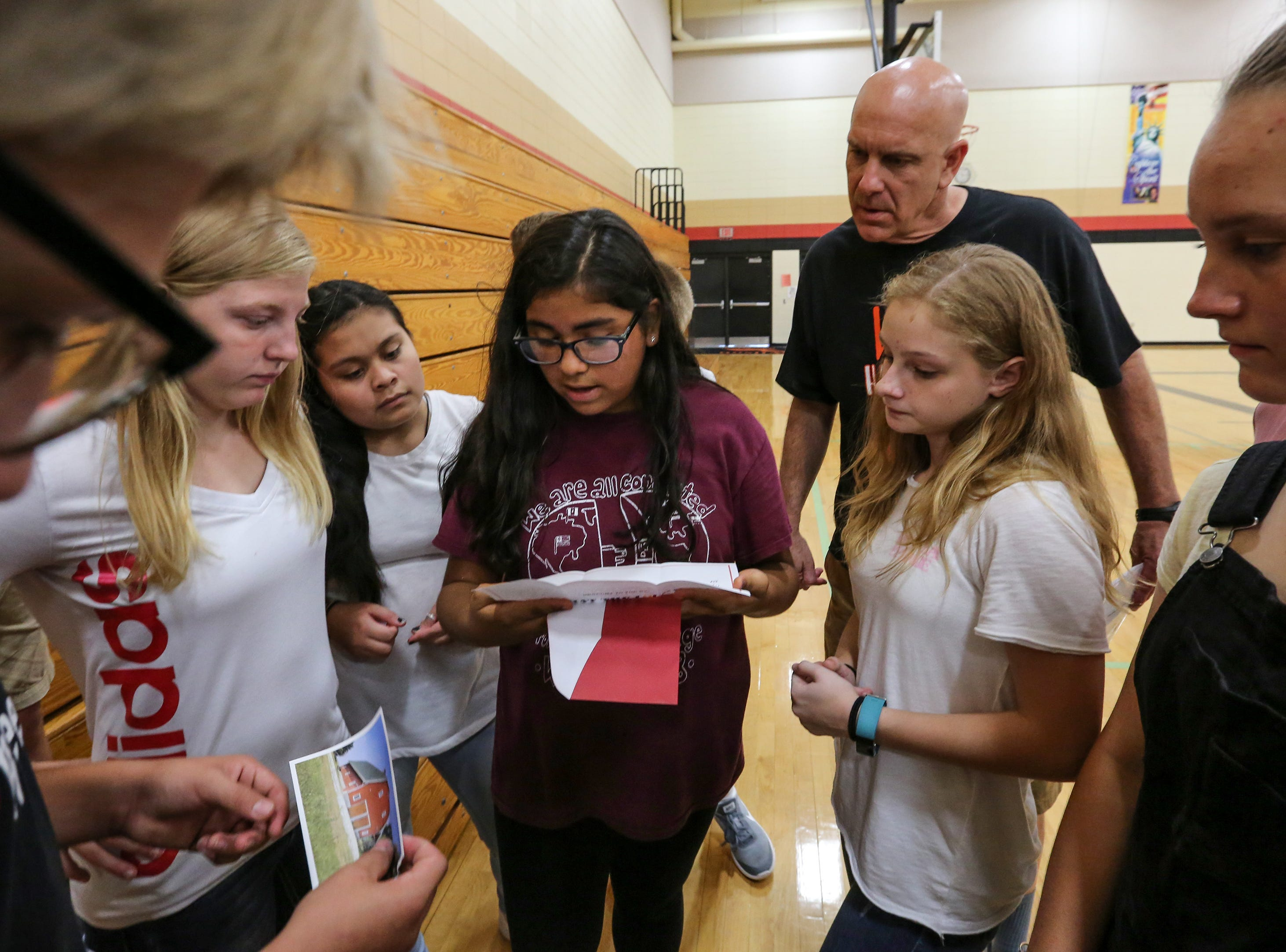 Cecilia Aldrich reads a clue to her classmates in Jeff Cavanaugh's 8th grade homeroom during an escape room activity on the first day of school at Wilson Junior High Tuesday, September 4, 2018, in Manitowoc, Wis. Local escape room What the Lock coordinated the clues for the students. Josh Clark/USA TODAY NETWORK-Wisconsin