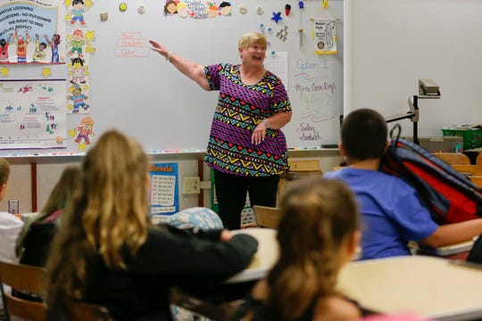 Fourth grade teacher Cary Moyer goes over supplies for her students on the first day of school at Madison Elementary School Tuesday, September 4, 2018, in Manitowoc, Wis. Josh Clark/USA TODAY NETWORK-Wisconsin