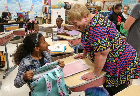 Amaya Harvey asks her 4th grade teacher Cary Moyer a question on the first day of school at Madison Elementary School Tuesday, September 4, 2018, in Manitowoc, Wis. Josh Clark/USA TODAY NETWORK-Wisconsin
