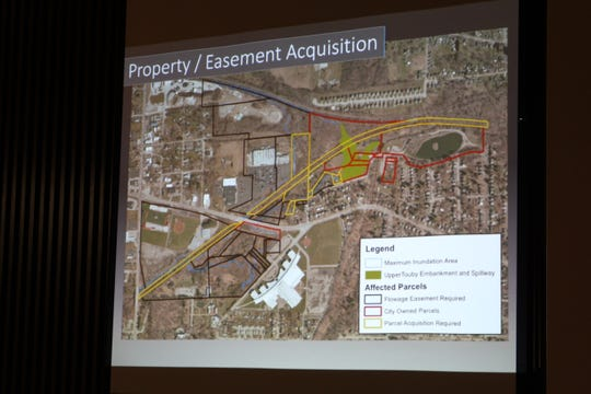 The city would need to acquire 16 parcels, including two homes, if it moves forward with a $15.5 million flood mitigation project that includes the construction of a dry dam at North Lake Park.
