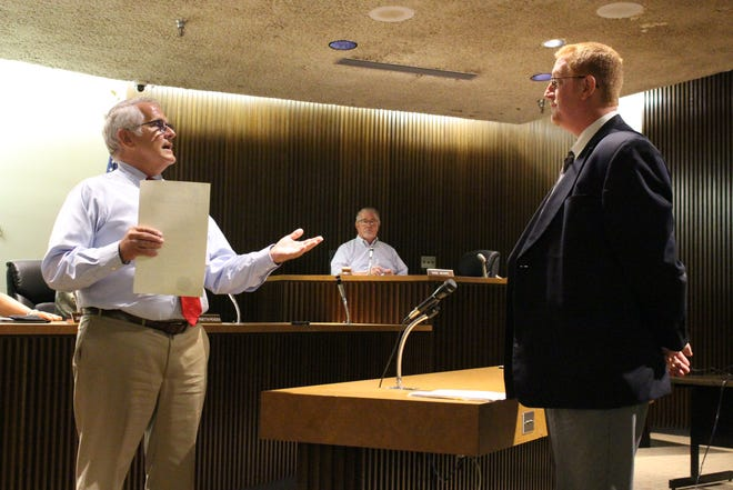 Mansfield Mayor Tim Theaker, left, talks to Joe Trolian, executive director of the Richland County Mental Health and Recovery Services Board, at Mansfield City Council on Tuesday, Sept. 4, 2018. Theaker read a proclamation declaring September National Recovery Month.