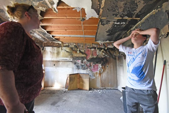 Laura Blevins and her grandson Khris Adkins-Tolbert , 11, were at a nearby store when they heard their home was on fire.