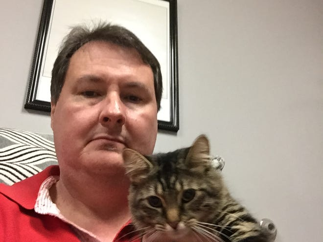 News Journal reporter Mark Caudill with his cat, Katy.