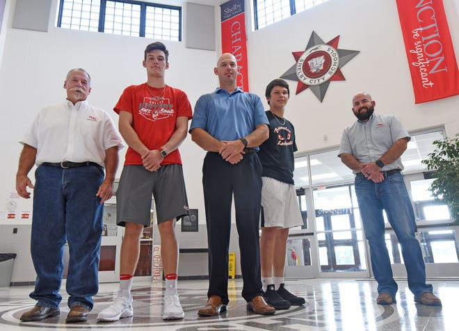 Three generations of Alberts who played football for the Shelby Whippets pose for a photo in the school on Tuesday. From the left are: Kenny Albert Jr., McGwire Albert, Matt Albert, Marek Albert and Jeff Albert.