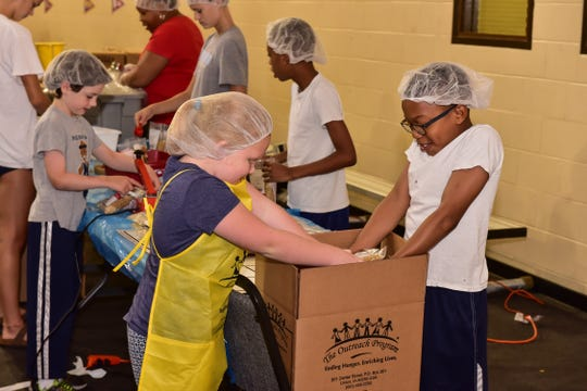 MIFA is celebrating its 50th anniversary this month during its CommUNITY days. Here volunteers from New Bethel Missionary Baptist Church, St. George's Episcopal Church, Germantown United Methodist Church and Germantown Presbyterian Church packed shelf-stable foods for the Mid-South Food Bank.