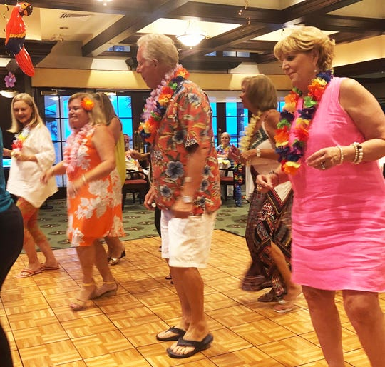 Yacht Club members danced the night away at Saturday's luau party.