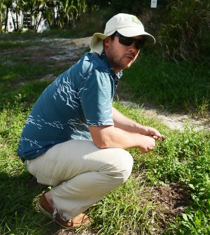 Chadd Chustz with the skull of a gopher tortoise in this file photo.