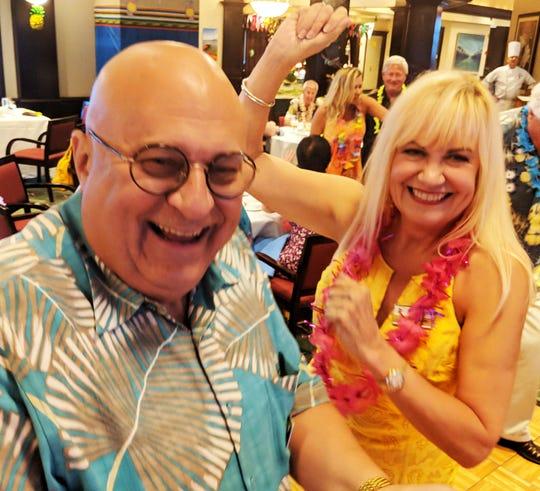 Members Bob Aber and Karena DeWitt enjoy the music.
