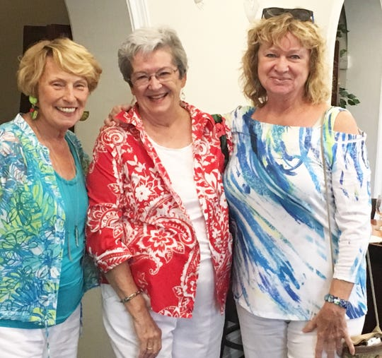 Co-host Jackie Hays, birthday girl Barbara Markel and co-host Cindy Crane.