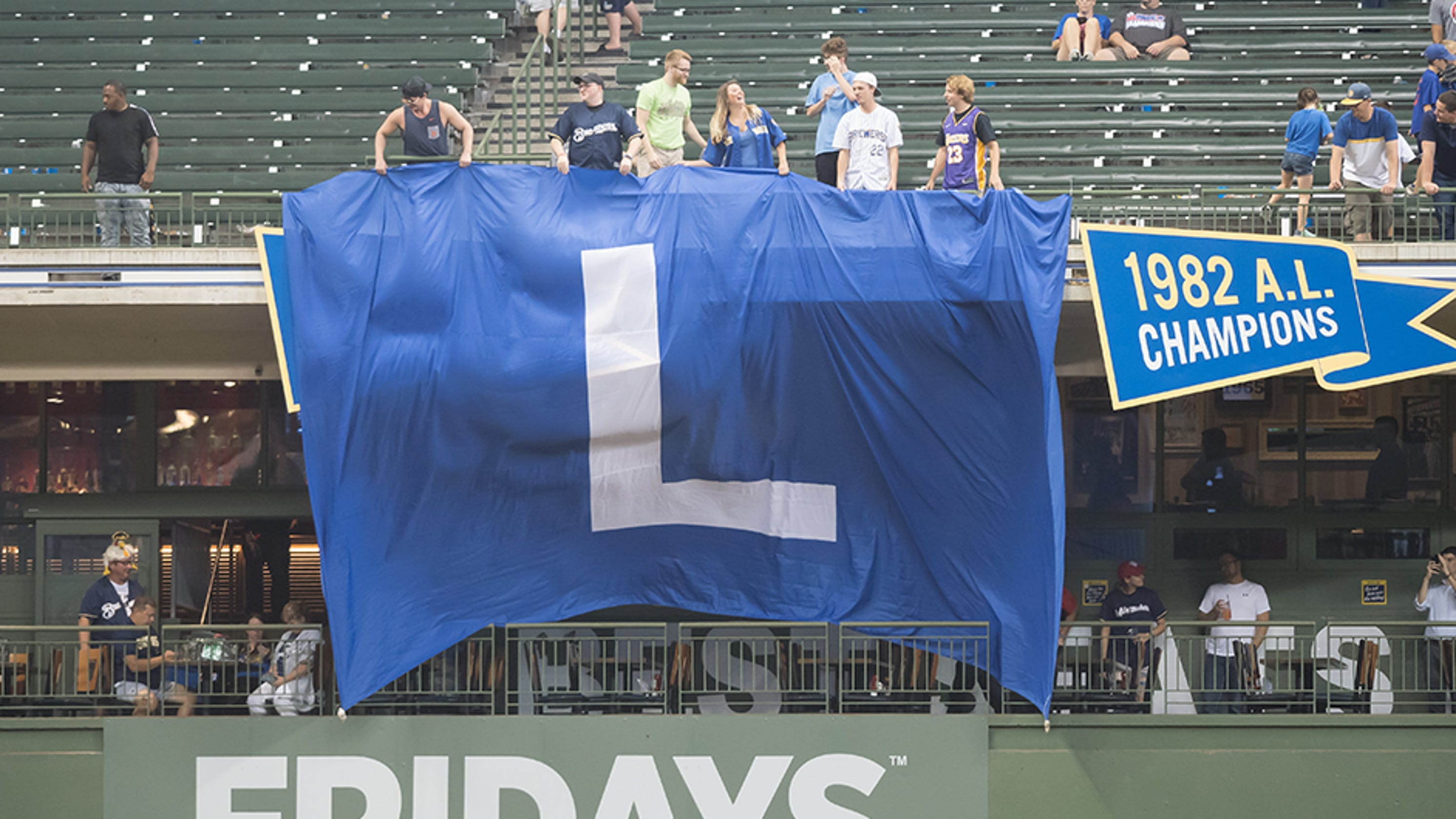 The story behind the giant  L  flag at Tuesday s Brewers game 4faecba1fe06