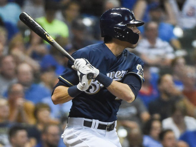 Christian Yelich laces a two-run double in the seventh inning for the Brewers against the Cubs.