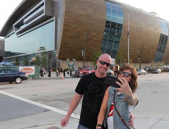 Meghan and Mike Holzbauer of Milwaukee pose for a selfie in front of Fiserv Forum before the grand opening concert in Milwaukee in September.