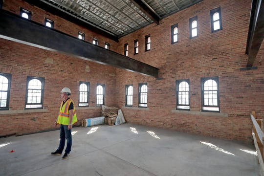 Joe Alexander, Alexander Co. president, stands in the penthouse located in the tower area of the Fortress Building. The 1,589-square-foot apartment will include two bedrooms and two bathrooms, and will rent for $3,700 a month.