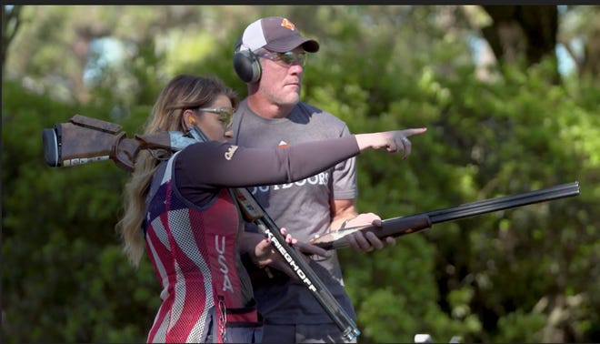 Brett Favre receives trapshooting tips from three-time U.S. Olympian Corey Cogdell-Unrein on an episode of USA Shooting by 4Outdoors. Favre created 4Outdoors to help get more people connected to outdoor activities.
