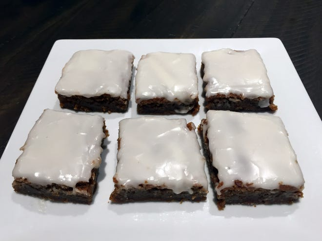 Gingerbread bars are chewy and sweet, topped with a powdered sugar glaze.