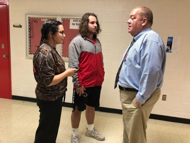 Flippin High School Principal Dale Horn (right) visits with (from left) senior Tehya Wilson and junior Trevan Hudson while walking the halls of the high school. Horn was hired at the end of the last school year to replace retiring principal Cassie Gilley.
