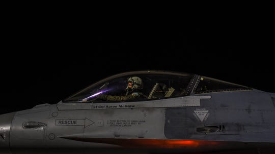 U.S. Air Force Capt. Don Roney, a fighter pilot, 100th Fighter Squadron, Montgomery Regional Air National Guard Base, performs preflight checks February 28, 2017, at Nellis Air Force Base, Nev.
