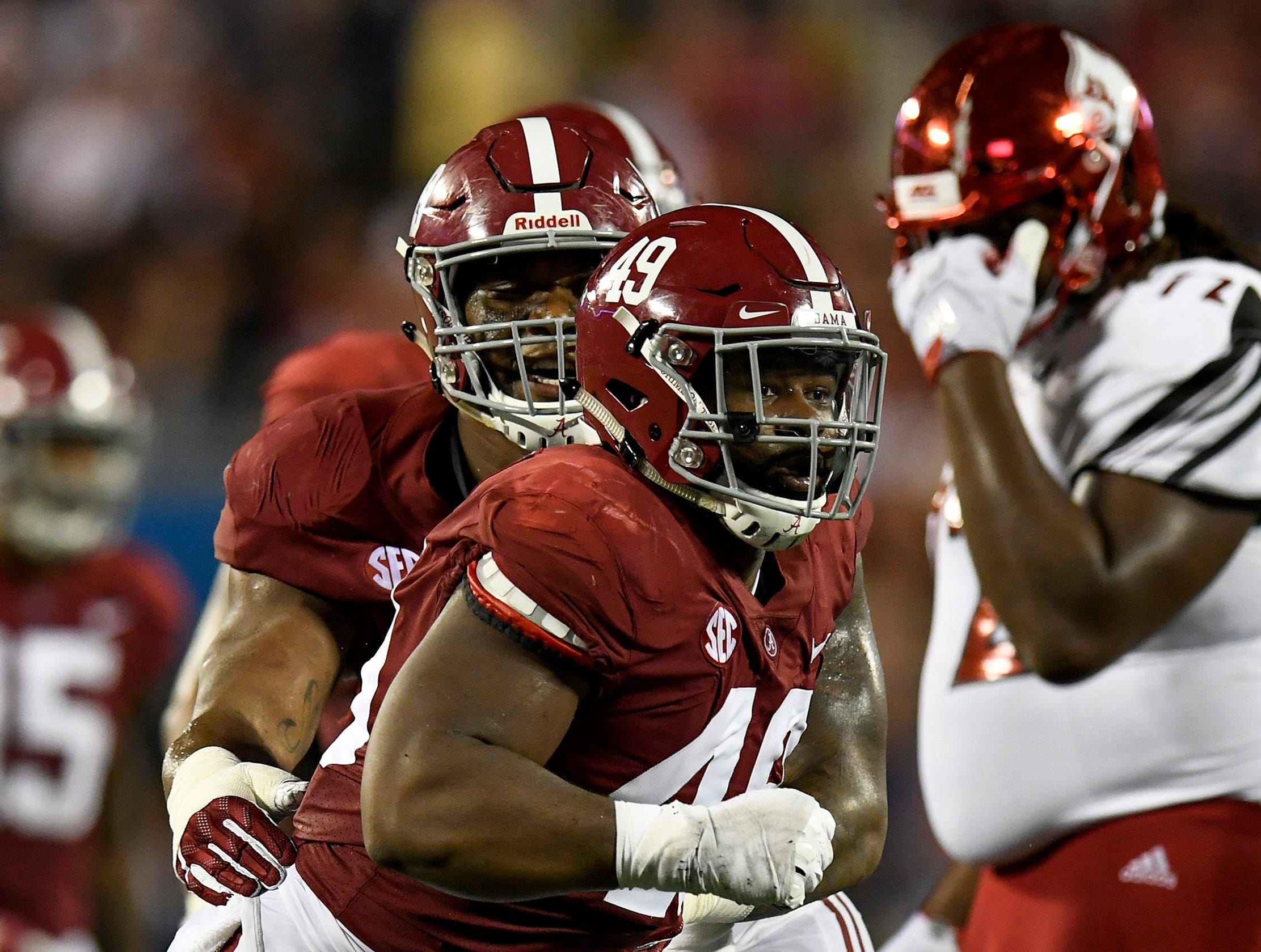 Alabama defensive lineman Isaiah Buggs (49) and defensive lineman Raekwon Davis (99) celebrate a Buggs sack against Louisville in second half action of the Camping World Kickoff at Camping World Stadium in Orlando, Fla., on Saturday September 1, 2018.