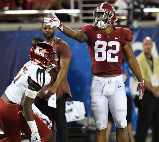 Alabama tight end Irv Smith Jr. (82) signals first down after making a catch against Louisville in second half action of the Camping World Kickoff at Camping World Stadium in Orlando, Fla., on Saturday September 1, 2018.