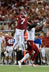 Alabama defensive back Trevon Diggs (7) breaks up a pass intended for Louisville tight end Kemari Averett (11) in first half action of the Camping World Kickoff at Camping World Stadium in Orlando, Fla., on Saturday September 1, 2018.