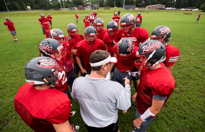 Lowndes Academy coach Shane Moye works with his players during practice in Hayneville, Ala., on Wednesday September 5, 2018.