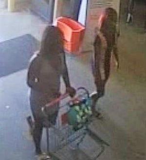 Suspects shown on surveillance photo.