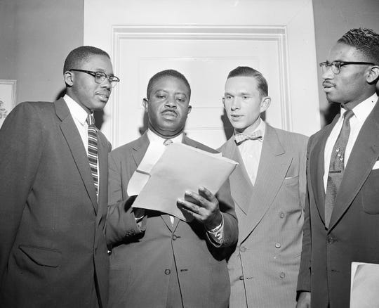 The Rev. Ralph D. Abernathy, center, speaks with attorney Fred D. Gray and the Rev. Robert S. Graetz about the bus boycott settlement in Montgomery on Feb. 21, 1956.