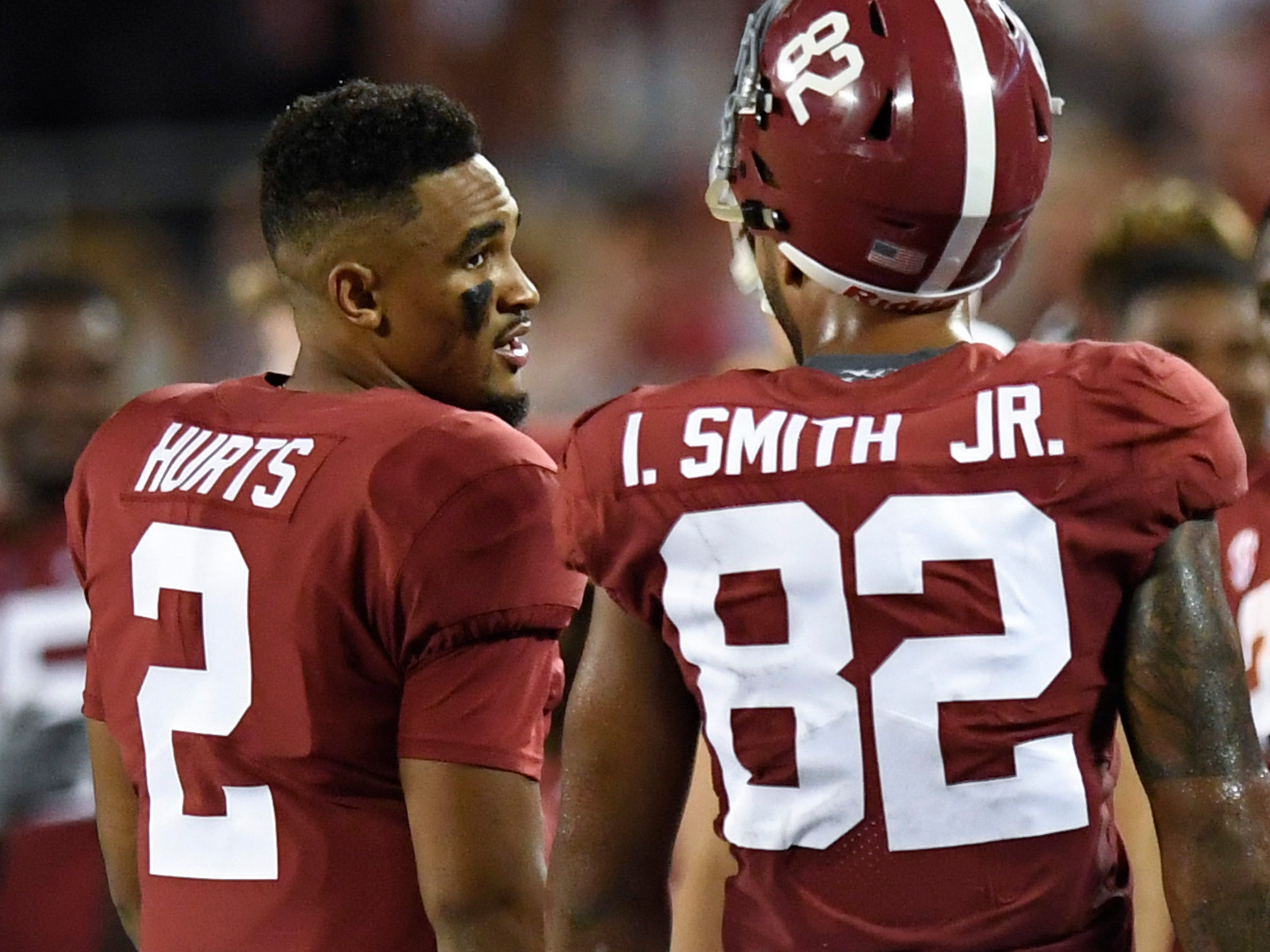 Alabama quarterback Jalen Hurts (2) talks with Alabama tight end Irv Smith Jr. (82) In second half action of the Camping World Kickoff at Camping World Stadium in Orlando, Fla., on Saturday September 1, 2018.