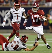 Alabama wide receiver Jaylen Waddle (17) runs against Louisville in second half action of the Camping World Kickoff at Camping World Stadium in Orlando, Fla., on Saturday September 1, 2018.