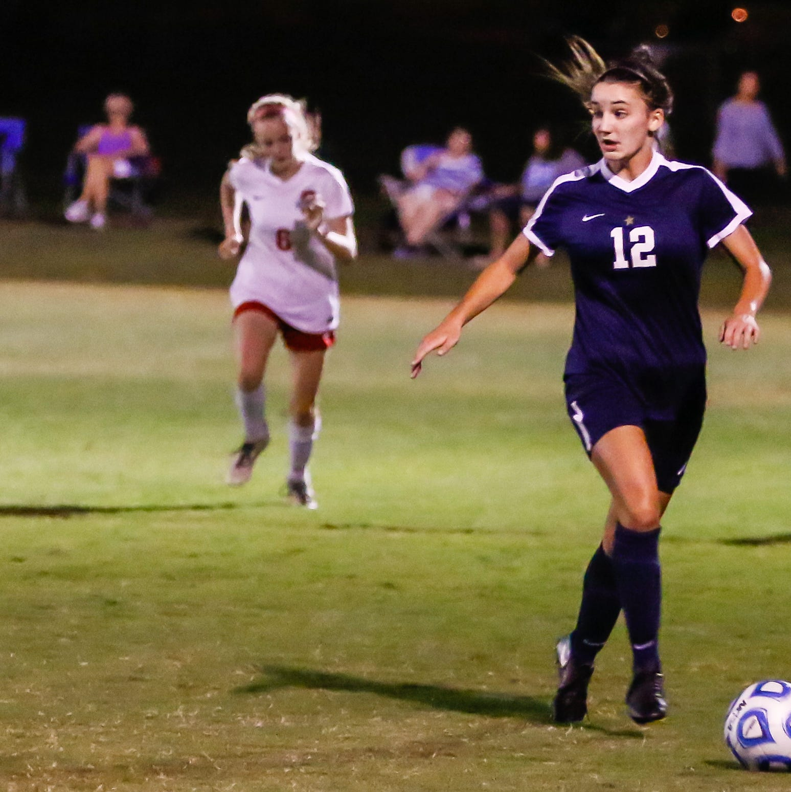 Siegel's Mia Roberts dribbles upfield during Tuesday's match against Oakland.