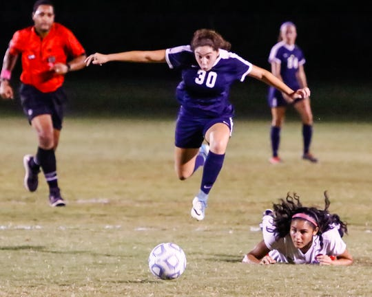 Siegel's Emily Sanchez leaps over a defender during a recent match. Sanchez was voted the area girls athlete of the week for Aug. 27-Sept. 1.