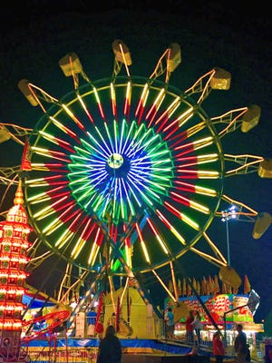 The Ferris Wheel is lit up nightly all week during the Dickson County Fair.