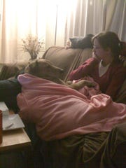 Sophie (in a Snuggie) snuggles with Natalie Corwin in 2008.