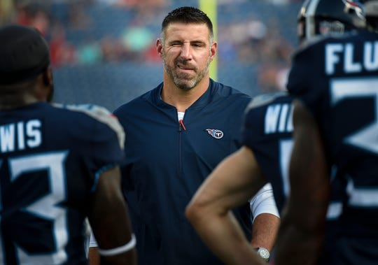 Titans coach Mike Vrabel gives a wink to his players as they warm up before a preseason game against the Buccaneers on Aug. 18 at Nissan Stadium.