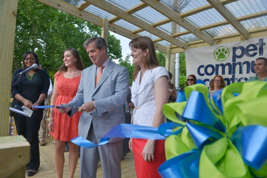 Mayor Karl Dean cuts the ribbon at Pet Community Center, a low-cost spay and neuter clinic, June 2, 2014, in Nashville.