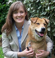 Natalie Corwin and her first Nashville rescue dog, Sophie, pose for a picture in 2010.
