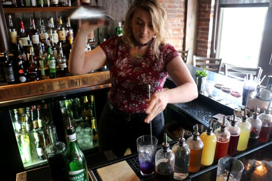 Heritage Ball cocktail creator Kala Ellis stirs and shakes ingredients for a drink inside Gray's on Main on Aug. 31, 2018.