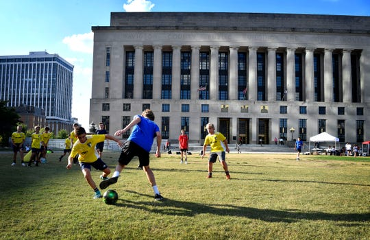 Youth soccer players hold an exhibition practice on the lawn of the courthouse before the final votes on Nashville's MLS stadium.