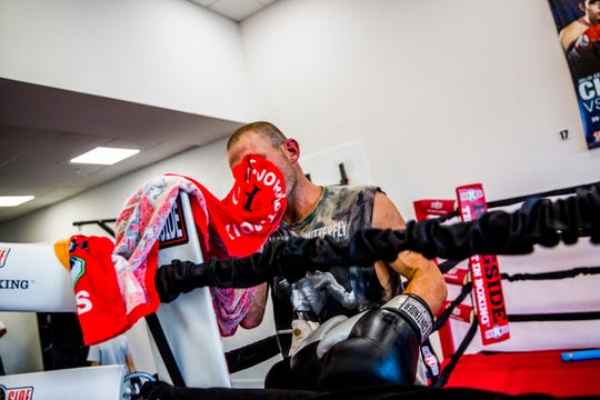 Tommy Bryant Jr., 29, wipes sweat off of his face during training at The Sweet Science boxing gym in East Naples on Tuesday, Sept. 4, 2018. Bryant went pro in 2010 and has been boxing since he was 10 years old. His next fight is Saturday.
