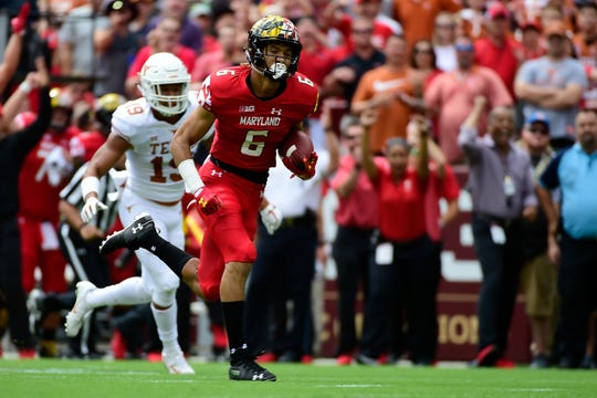 Maryland Terrapins wide receiver Jeshaun Jones (6), a South Fort Myers graduate, runs past Texas Longhorns defensive back Brandon Jones (19) for a first quarter touchdown at FedEx Field on Saturday in Landover, Md.