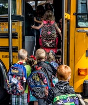 Students at Grafield Elementary crowd onto their bus for an early dismissal due to the heat. The school which houses kindergarten through second grade does not have air conditioning. Stevenson Elementary in Heath also dismissed their students early.