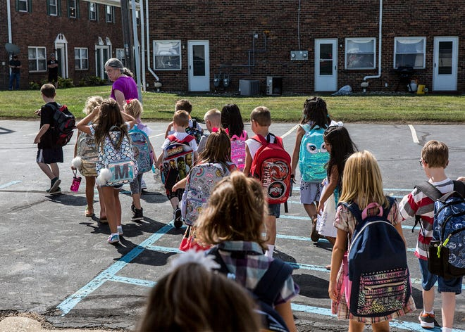 Students at Grafield Elementary leave for an early dismissal due to the heat. The school which houses kindergarten through second grade does not have air conditioning. Stevenson Elementary in Heath also dismissed their students early.