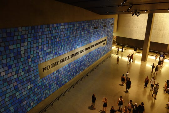 "A repository for the unidentified remains of 9/11 victims sits behind a wall at the 9/11 Memorial & Museum inscribed with a quote from Virgil: ""No day shall erase you from the memory of time."""