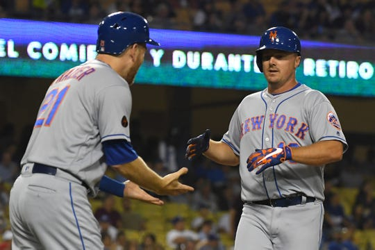Sep 4, 2018; Los Angeles, CA, USA; New York Mets right fielder Jay Bruce (19) is greeted by New York Mets third baseman Todd Frazier (21) as he crosses the plate after hitting a two run home run in the first inning against the Los Angeles Dodgers at Dodger Stadium.