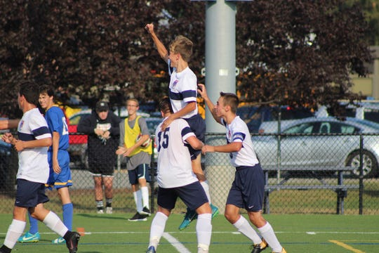 Sophomore Joey Carbone, top, celebrates after scoring a goal in a game last season. Carbone is expected to contribute for the Golden Panthers in 2018.