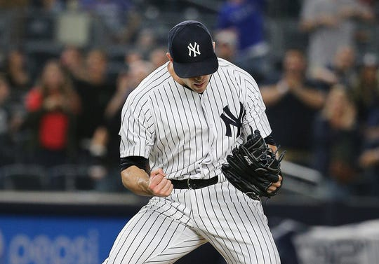 Aug 31, 2018; Bronx, NY, USA; New York Yankees relief pitcher David Robertson (30) reacts after defeating the Detroit Tigers at Yankee Stadium.