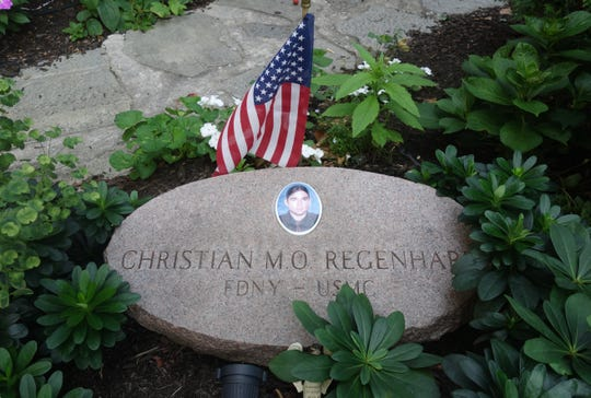 A memorial stone for Christian Regenhard, a firefighter who died in 9/11, at the Church of the Good Shepherd in Upper Manhattan.